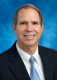 Thomas E. Laux